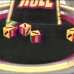 This is what the contestant got on his first roll: 4 cars and $1,000. He decides to roll again.