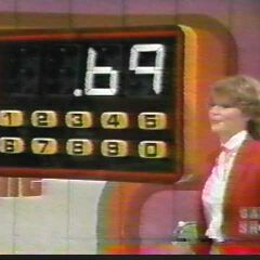 The contestant guesses 69 cents for one of the grocery items as Holly punched it out on the calculator