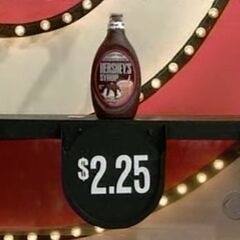 Next, she picks 4 Hershey's chocolate syrups which come to...
