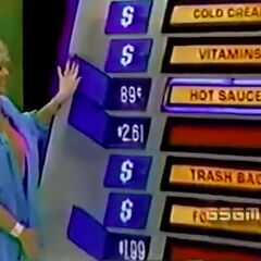 The in-studio contestant picks the hot sauce and is correct.