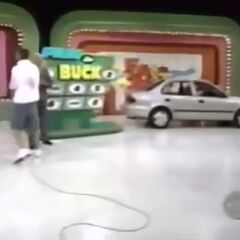 He wins the car and $1,000 for gas money.
