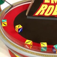 On his first roll, he has 3 cars and $2,000. He decides to roll again.