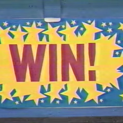 The ultra cool win tag, from 1988. The letters are in purple. The spark is yellow and the background is blue.
