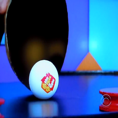 Notice the show's logo on the white ball?
