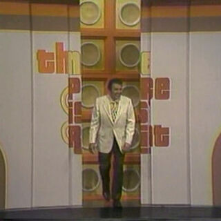 Dennis making his entrance on the very first nighttime episode of <i>TPiR</i>, which was taped the very same day the premiere of the daytime version with <a href=