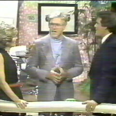 Tom chatting w/ Susan and original <i>Wheel</i> host Chuck Woolery at the end