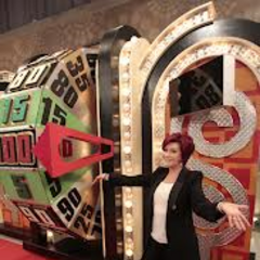 <i>The Talk's</i> Sharon Osbourne poses next to the Big Wheel during her appearance of