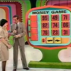 Here's Money Game played on the stage floor again, but now with the name on the board. Should you find the front of the car and the back of the car, its shape is black and the background is yellow seen here.