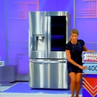 She picks the refrigerator.