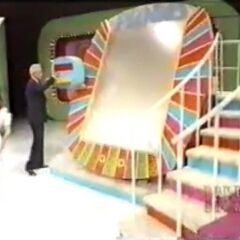 Here is the next look of Plinko. Notice the Plexiglass cover and extra rail on the stairs.