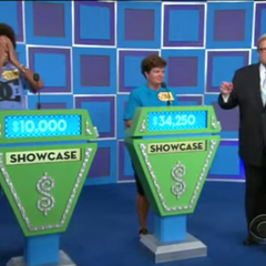 The early season 38 bidding displays. The showcase podiums are identical. See how the bids are not centered, this only lasted during the first two episodes in Season 38. On top of that, the screens were aqua blue.