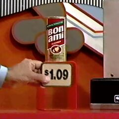 Next, he picks 1 Bon-Ami cleaner for a total of...
