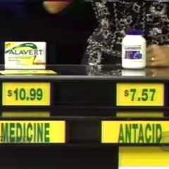 She says the antacid is lower than the medicine. She is correct. She has 3 rolls.