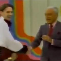 Chad shakes Bob's hand.