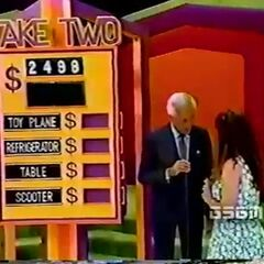 Which two prizes total $2498?