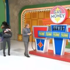 She wins the car and $10,000!