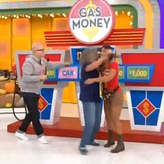 She has won the car and $10,000!