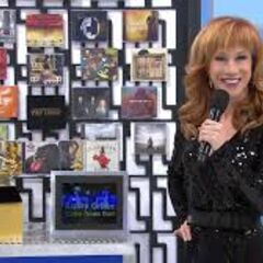 Comedienne Kathy Griffin smiles at the cameraman while presenting her Grammy-themed showcase