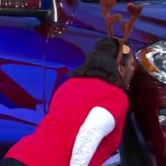 This contestant is so excited that she gave the car a kiss for good luck.