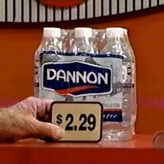 First, she picks 6 Dannon 6-pack waters which come to...