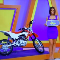 She picks the Honda CRF motorcycle.