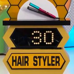 She bids $35 on the hair crimper. A difference of $5. She picks card #22.