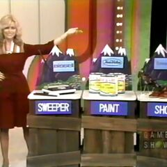 Barbara bids $39 on the Bissell carpet sweeper.
