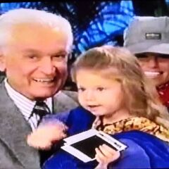 Bob holding a little girl, waving goodbye to the camera at the end of a