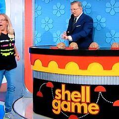 She picks shell #2.