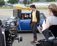 3x4BTS-FilmingRunwayCarScenes
