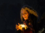 Mother Gothel with the flower