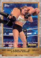 2020 WWE Countdown to WrestleMania (Topps) Kurt Angle and Ronda Rousey Def. Triple H and Stephanie McMahon (No.18)