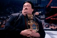 Paul bearer with wwf belt