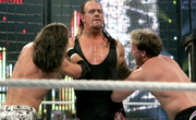 Taker double chokeslam