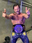 KennyOmega AAA Champ