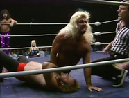 Michael Hayes chokes Alan Martin in front of referee Tommy Young