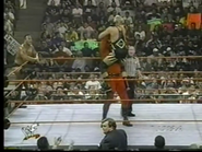 Kane gives Owen Hart a chokelift