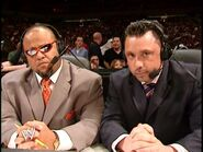Tazz and Michael Cole