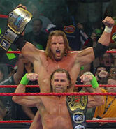 1st reign as unified tag team champions from dx (triple h & shawn michaels)