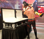 Kane vs Punk Casket