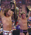 2nd unified tag team champions edge and chris jericho