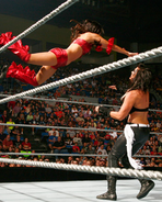 Nikki jumping on Katie Lea