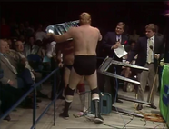 Dick Murdoch uses the announcer's chair