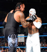 Taker choking Rey