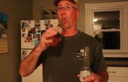 Larry drinking beer