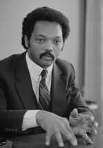 Jesse Jackson, half-length portrait of Jackson seated at a table, July 1, 1983