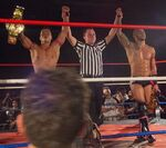 Yoshino and Ricochet Tag Champions