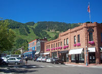 Downtown Aspen, CO, with view to ski slopes