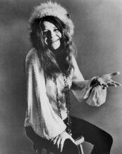Janis Joplin seated 1970