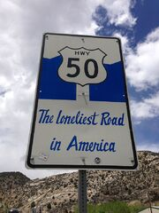 2014-05-21 12 23 20 Sign for the Loneliest Road in America along U.S. Route 50 westbound just west of downtown Ely, Nevada